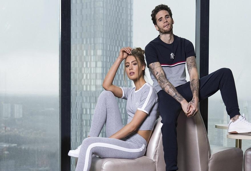 Weibliches und männliches Model in Trainingshosen und Sweatshirts von Gym King