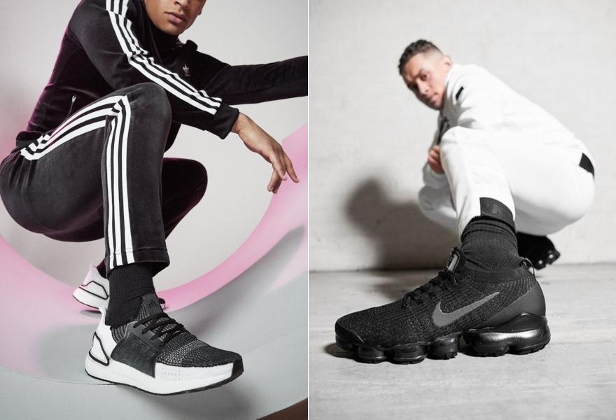 Mann mit schwarz-weißen adidas Ultraboost 19 und Mann mit schwarzen Nike Vapormax.